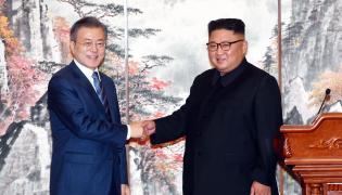 Mun Dze In i Kim Dzong Un