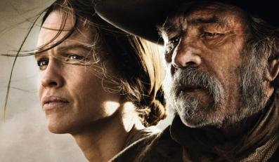 "Tommy Lee Jones i Hilary Swank na plakacie reklamującym ""The Homesman"""